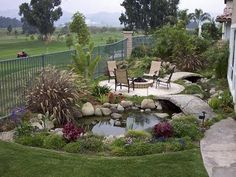 Cute patio with path over koi fish pond.