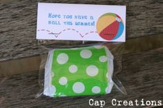 a folded beach ball in a bag with a cute bag topper (printable available). good for end of summer/back to school or as a thank you for attending party.