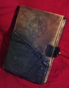 A leather bound grimoire purported to be the John Dee copy of the Necronomicon. Discovered in a crypt in London by Dr. Killian, most of the text is written in Latin with a few passages in Old English. Included are numerous illustrations of the Elder and Outer Gods as well as several chants and diagrams intended for summoning. Much of the books contents are enigmatic and several of Killian's subsequent protege's spent many years attempting to decipher them. (sold - private collection) #occult