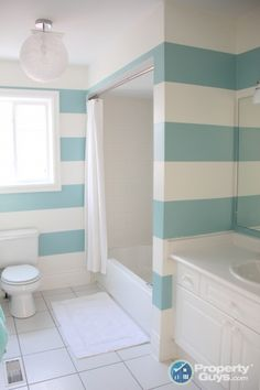 Make a plain white bathroom fun with turquoise stripes... http://www.bathroom-paint.net/bathroom-paint-color.php