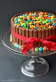 M and M's and Kit Kats. The center is a layer cake.