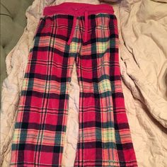 Fuzzy Multi-Color Plaid Pj Pants Soft and fuzzy pjs are a must for the winter. Pink, purple, blue, and white make up the plaid pattern. Barely used(the strings are a bit frayed but otherwise great condition!). Intimates & Sleepwear Pajamas