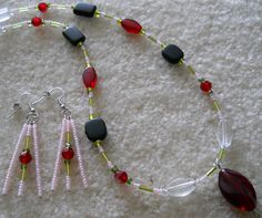 All Handmade with Pink Seed Beads, Green Bugle and Czech Glass E-Beads, Red, Black and Clear Acrylic Beads, centered by a Red Oval Acrylic Bead!  Necklace is connected with Spring Ring Clasp and Matching Earrings with fish/french hook wire   Necklace Size - 19 1/2""