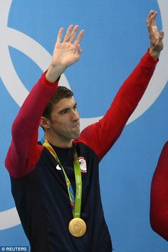 But Phelps let the tears flow as he waved to the roaring crowd...