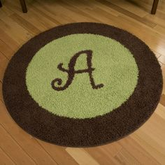 Chirp 4-foot Round Border Rug with Initial | Carousel Designs  #carouseldesigns #nursery