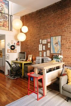 """CB's Quirky & Personal Duplex (via Apartment Therapy)  Love the desk and """"office"""" within the living room lay out"""