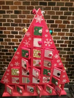 Advent calender. You can find this seller at: http://serendipityhandmade.co.uk/index.php/paper/crafts/vendors/m3allitts_store-vendor-8
