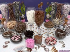 Brown Candy Buffet    Brown candy buffets can include more than delicious chocolate. Here we see taffy, rootbeer flavored lollipops, coconut, gumballs, and gummy cola bottles combined with classic chocolate flavors.