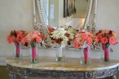 Classic white bridal bouquet and coral bridesmaids' bouquets at The Perry House. Fleurish Floral Designs