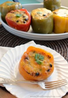 Slow Cooker Stuffed Bell Peppers with Quinoa, Black Beans, and Corn by Bless This Mess