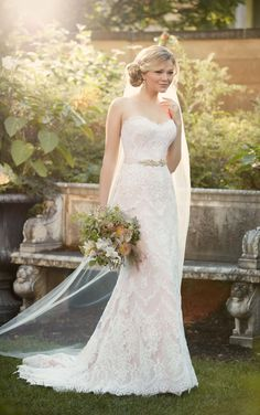 Essense of Australia's sheath wedding gown is made from lace over matte-side shell satin that carries through to a chapel train.
