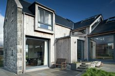 Russwood Timber Cladding provides an attractive & durable external finish which is renewable, reusable, biodegradable & contains minimal embodied energy. Larch Cladding, Wall Cladding, House With Porch, House Front, Scottish Cottages, Square Windows, Stone Barns, Modern Farmhouse Exterior, Modern Barn