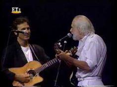 """Georges Moustaki, a wonderful French singer-songwriter of Italo-Greek Jewish origin, best known for his poetic rhythm, simplicity and romantic songs, died today May 23, 2013. In this clip he sings along with George Dalaras """"Le Meteque"""" (""""Ο Μέτοικος"""") one of his most beautiful songs... ~ Paris, """"Palais de Congres"""" 1996"""