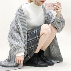 Love this look: oversized cardigan, mockneck, plaid skirt.
