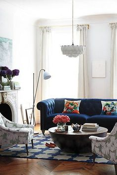 Indigo Velvet Chesterfield Sofa in global and eclectic living room, cool and colorful, pattern and repose, historic brownstone, sitting room
