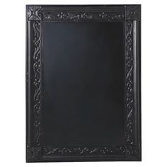 Distressed metal-framed chalkboard with scrolling detail.  Product: ChalkboardConstruction Material: MetalColor: BlackFeatures: Scrolling detailDimensions: 44 H x 32.25 W x 2.25 D