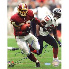 This Steiner Sports official photograph is hand signed by Washington Redskins running back Clinton Portis. This 8x10-inch photograph shows Clinton Portis running the ball against the Houston Texans. P