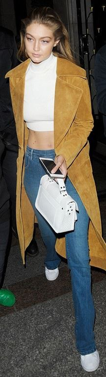 Who made Gigi Hadid's white handbag, cropped top, and brown suede coat?