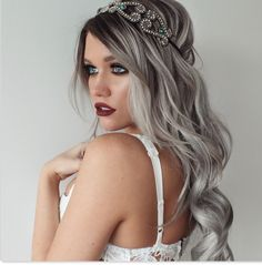 Titanium silver hair with shadow roots.
