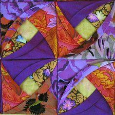 Kaffe Fassett quilt close up, folded fabric, at Hanne's Quilt Corner