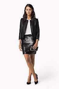 Geselecteerd door onze guest editor, Alexa Chung.<br/><br/>Voeg sprankeling toe aan je feestlook met deze paillettenrok. Gemaakt van zachte, stretchy jersey in een aansluitende pasvorm die boven de knie valt.<br/><br/>Ons model is 1,76m en draagt een Tommy Hilfiger rok in maat S.