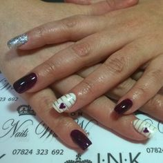 Nicola Eadsforth teams dark purple nails with sparkle and stripes.