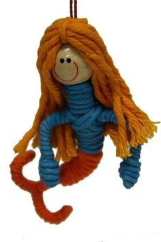 Fair Trade Yarn Mermaid Ornament, Colombia - Cotton yarn is hand-wrapped to create this cute ornament that is handmade in Colombia. These ornaments are made by single mothers in a rural Colombian town where there are limited opportunities for employment. Your purchase allows these women to care for and serve as role models for their children.
