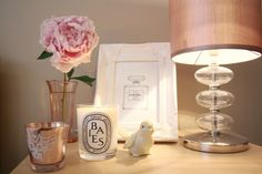 Perfect bedside table. Diptyque candle. Pink peony.