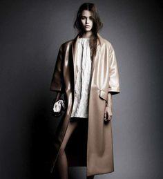 Interview Magazine COAT, DRESS, BAG, AND SHOES: MIU MIU.  BRACELET: DEZSO.  RING: SOPHIE BILLE BRAHE.