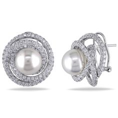 These exquisite stud earrings from the Miadora Collection feature 11-12 mm South Sea white pearls amid swirls of shimmering round white diamonds. This stunning one-of-a-kind pair is set in 18-karat wh