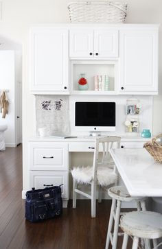 cabinets on a wall for home office space in a larger room