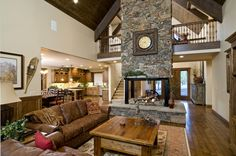 Would love to have a similar four sided fire place as a centre piece in the living/dining room.