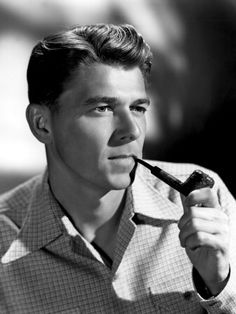 Ronald Reagan, smoking a pipe