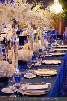 Royal blue tables with pops of gold and silver featuring phalaenopsis and dendrobium orchids, hydrangea and French tulips. @grace_ormonde @wedding_style