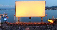 Orange outdoor cinema, Zurich Outdoor Cinema, Zurich, Things To Do, Table Lamp, Orange, Lighting, Travel, Home Decor, Press Release