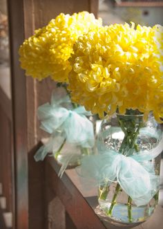 Flower arrangement. I like the use of simple material tied around the glass!