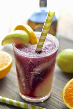 Frozen lime margaritas with a swirl of frosty and fruity sangria - the perfect summer cocktail #margarita #sangria #summersoiree