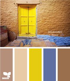 I like this palette.  You can stick with beige and add towels or mats in the yellow and blue. Nothing drastic, but the pops of color will add a nice touch.