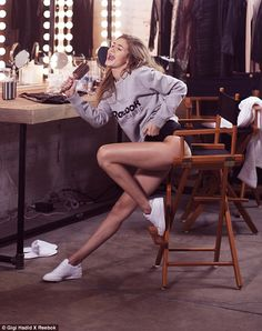 Having a whale of a time:Sitting on a high chair, the statuesque model showed off a rarely-seen fun side as she mimed singing into a hairbrush