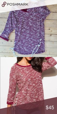 Burgundy marble sweater with lace up sides Beautiful style with lace up ties sweater tie tone marble Like burgundy. 19 laying flat small bust seam to seam. 20 laying flat seam to seam. 21 inches laying flat seam to seam. Sweaters Crew & Scoop Necks