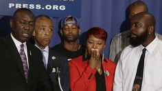 (LR front) Brown family attorney Benjamin Crump, US civil rights leader Rev.  Al Sharpton, the parents of Michael Brown, Lesley McSpadden and Michael Brown, Sr.  appear at a news conference at the National Press Club in Washington September 25, 2014 (Reuters / Gary Cameron)