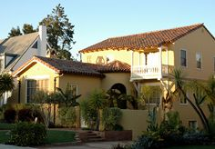 Yellow house, white Romeo & Juliet Balcony, Spanish style, wealthy neighborhood, San Mateo, California, USA by Wonderlane, via Flickr