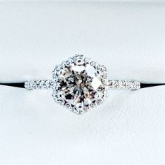 round cut with a unique hexagon halo tastefully complimented with a petite pavé setting.