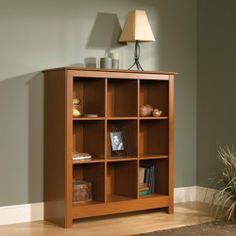 "Bookcase Storage Organizer - Mission Cherry Finish by Sauder. $129.98. Features This handsome piece of storage furniture features cubbyhole storage for books, framed photos, collectibles, and more. Six adjustable shelves. Mission Cherry finish.     Dimensions W:43 1/2"" (110.4cm) D:15 1/2"" (39.4cm) H:48 1/8"" (122.2cm). Comes ready to assemble. Please contact Target Decor and More for free color sample. Color may vary from pic."