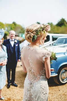 Viola by Claire Pettibone. Bride in floral crown.  http://www.rossharvey.com/