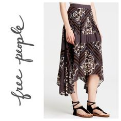 "🍁 Free People Printed Paradise Midi Skirt Neutral, earth-tones, stripes, and hand-drawn flowers define the pattern of this pleated, midi skirt. It's flowy fabric and handkerchief hem are perfect for festival season. It also has a banded waist and hidden back zipper with a hook and eye closure as well as usable pockets! The iPhone 5 in the last photo is to show size.  Approximately 28"" - 36"" long. Approximately 14"" across the waist band, laid flat.  Model is 5'11"" 34-24-35 and is wearing a…"