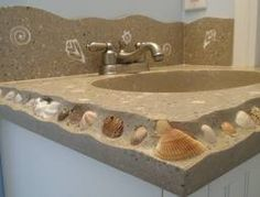 Like the idea of using seashells in the concrete form.