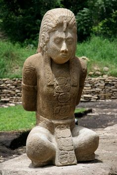 """One of two stone sculptures from Tonina, near Ocosingo, southern Mexico. The 1,300-year-old limestone sculptures of captured Mayan nobles shed light on war and the fragile alliances among Mayan cities during the civilization's twilight [Credit: AP/Moyses Zuniga]. This captive of ruling elite from rivalrous Lakam Ha, palatial capital of the city-state known variously as B'aakal and Na Chan Kan, """"Place of Skulls"""" and """"City of Serpents,"""" endured public humiliation and ritual torture."""