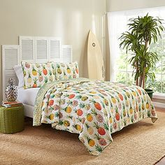 Dive into a tropical paradise with the fresh look of the Vue Kokomo Reversible Quilt Set. A vibrant mix of pineapples perfectly complement its abstract ombre reverse, creating a sumptuous layer of natural tranquility stylish enough to doze off in.