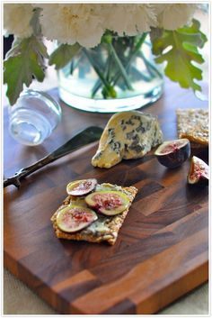 TWO HOLIDAY APPETIZERS  Grainy flatbread with creamy bleu cheese, sliced figs, honey  and   Sliced pear with triple cream brie and candied pecans